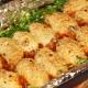 Особенности и рецепты приготовления фаршированных кальмаров в духовке